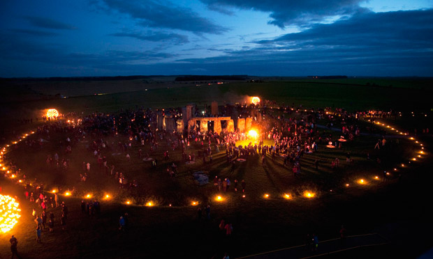 Stonehenge lit up early on 11 July 2012 with fire sculptures and candle-lit paths to mark Olympics