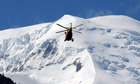 A rescue helicopter over Mont Blanc