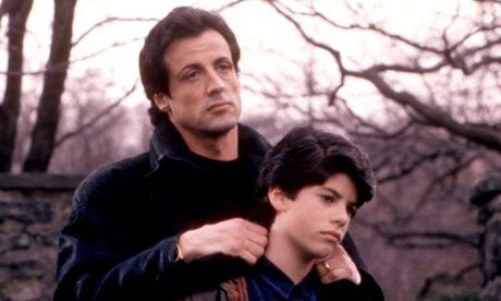 A young Sage Stallone with his father in Rocky V (1990).