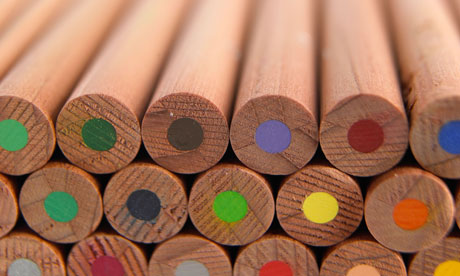 A stack of wooden coloured / colored pencils