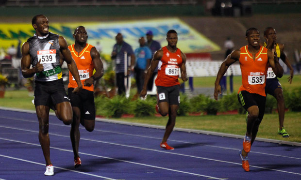 Usain Bolt (left) and Yohan Blake (right) compete in the men's 200m final at the Jamaican trials