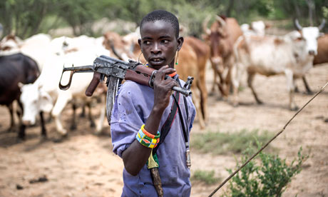 Korinamba Ruto, 14, herds cattle in Kenya's Rift valley with a gun for protection against rustlers