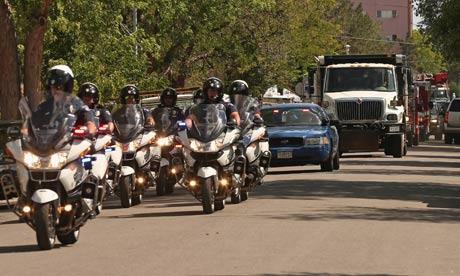 The Aurora police department escorts a truck