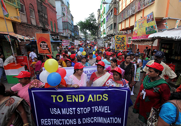 Sex workers march for rights and Aids awareness in Kolkata – in