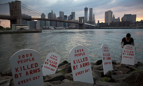 Fake tombstones are placed along New York's East River by members of the Control Arms Coalition to coincide with the UN conference on the arms trade treaty. Source: guardian.co.uk