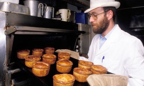 Pork pies coming out of the oven