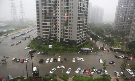 Cars submerged in floodwaters around a residential block after heavy rains in Beijing this week. 