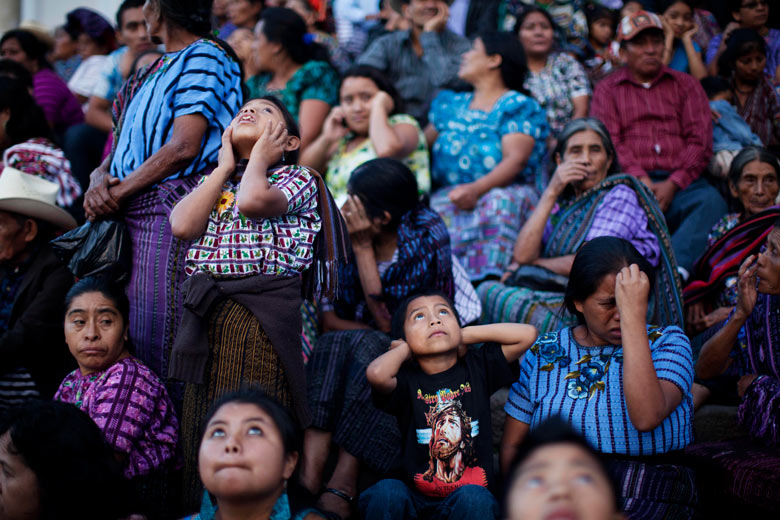 Villagers react to a fireworks during celebrations in Santiago Atitlan, Guatemala