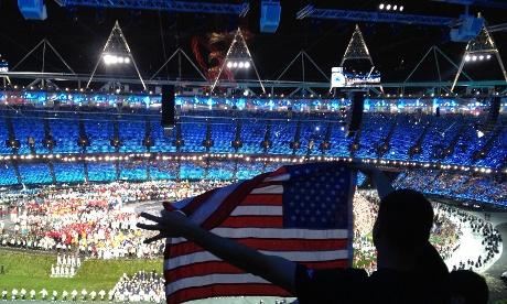 A US fan waves a flag