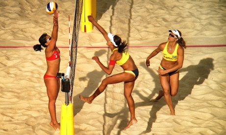 Brazil's Juliana Silva spikes the ball past Mauritian Niuon Chin Elodie Li Yuk Lo