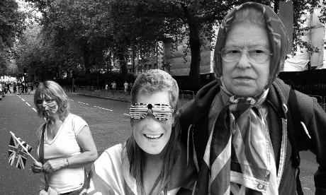 Spectators dressed in royal family face masks
