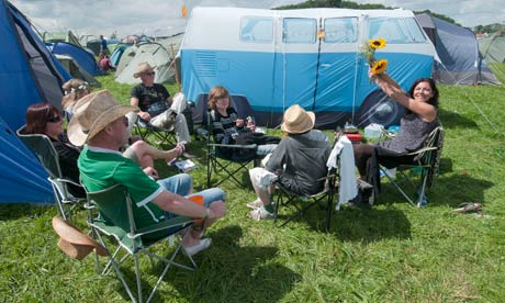 Campers with a tent in the shape of a VW camper van at WOMAD