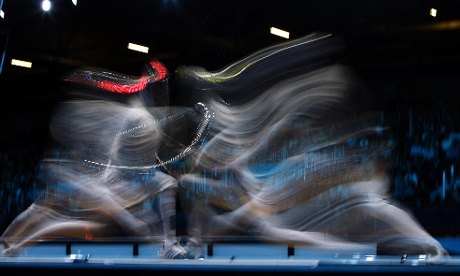 Motion blur: South Korea's Bongil Gu and Romania's Florin Zalomir compete during the men's individual sabre round of 32 fencing. Photograph: Andrew Medichini/ AP