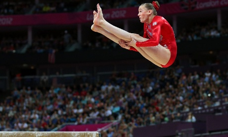 Rebecca Tunney of Great Britain dismounts the beam in the Artistic Gymnastics Women's Team qualification at the North Greenwich Arena. Photograph: Cameron Spencer/ Getty Images
