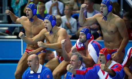 Showing aggression even from the sidelines, Serbia's players cheer for their team during their men's preliminary round Group B water polo match against Hungary at the Water Polo Arena. Photograph: Laszlo Balogh/ Reuters