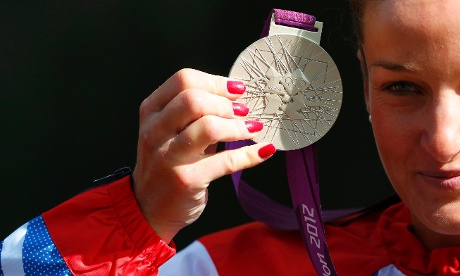 Our first medal! Britain's Elizabeth Armitstead holds her silver medal during the victory ceremony for the women's cycling road race. Photograph: Cathal McNaughton/ Reuters