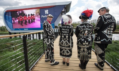 London Pearly kings and queens in front of a screen showing marching guardsmen, you can't get much more Great Britain than that. Photograph: David Levene for the Guardian