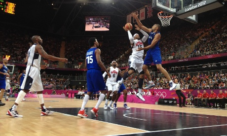 Team USA's Anthony Carmelo is blocked as he jumps for the hoop in the game against France