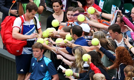 Andy Murray signs autographs for fans after his victory