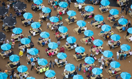 People enjoy the eating and resting areas of the Olympic Park