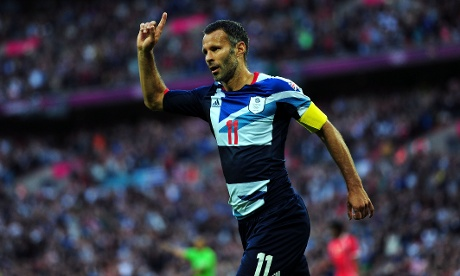 Ryan Giggs celebrates scoring the opening goal during the Men's Football first round Group A Match