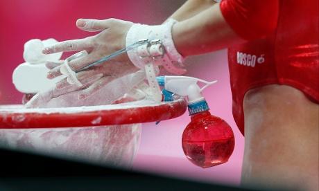 Aliya Mustafina chalks her hands