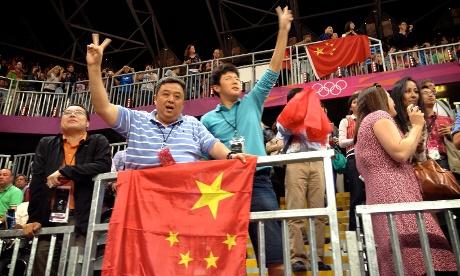 Chinese fans cheer their basketball team