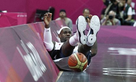 USA's LeBron James falls over