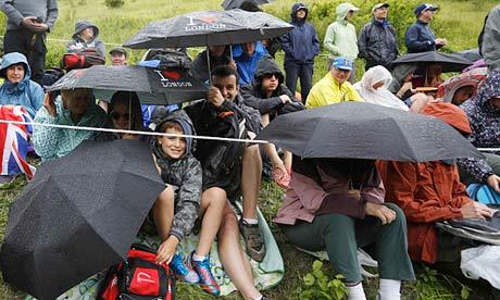 Olympics women's road race spectators shelter from rain at Box Hill