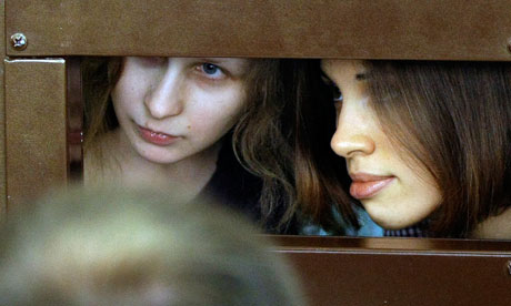 Maria Alekhina, left, and Nadezhda Tolokonnikova, right, members of feminist punk group Pussy Riot, in a Moscow court.