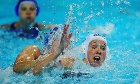 Chloe Wilcox of Great Britain battles with Olga Beliaeva of Russia during the Women's Water Polo Preliminary match between Great Britain and Russia on Day 3 of the London 2012 Olympic Games