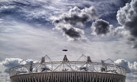 The blimp passes over the Olympic stadium