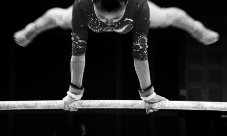China's He Kexin competes on the uneven bars in the Women's team Artistic Gymnastics at the North Greenwich Arena