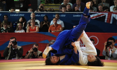 Japan's Yoshie Ueno wrestles with Korea's Jung Da-woon in Judo at the ExCeL centre
