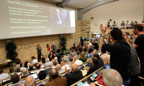 Higgs boson: Participants applaud after the presentation of the Atlas experiments