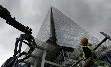 A worker looks up at the Shard