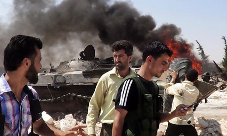 Citizen journalism image reportedly showing Free Syrian Army soldiers standing near a tank in Idlib