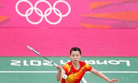 Li Xuerui of China plays against Taiwan's Tai Tzu-ying during their women's singles badminton match