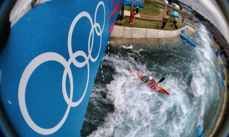 Spain's Samuel Hernanz paddles under the Olympic rings on the Kayak Single K1 course