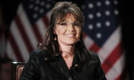 WOODBURY, NY - FEBRUARY 17:  Former Alaska governor and Republican vice president candidate Sarah Palin sits before speaking at the Long Island Association's annual meeting February 17, 2011 in Woodbury, New York.  Palin discussed issues including the economy, health care, oil drilling and her possible presidential aspirations.  (Photo by Mario Tama/Getty Images) *** Local Caption *** Sarah Palin bracelet flag Politics