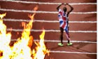 Mo Farah is seen through the heat of the Olympic flames