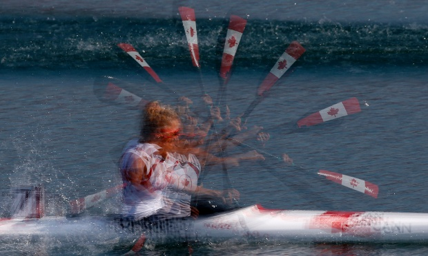 A multiple exposure shot of Canada's Emilie Fournel competing in the women's kayak single 200m heat.