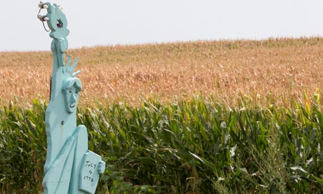 Lady Liberty stands in front of a parched corn field in Nebraska