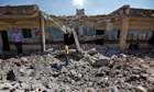 Syrians survey bombed school
