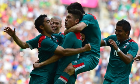 Mexico's forward Oribe Peralta (C) celebrates with teammates after he scored his team's second goal against at Wembley stadium.