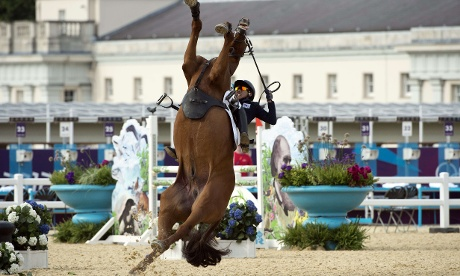 South Korea's Hwang Woojin loses control of his horse during the Show Jumping event of the Modern Pentathlon.