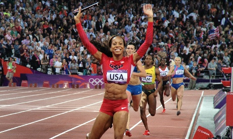 Sandra Richards Ross crosses the line in the women's 4 x 400m relay at the Olympic stadium