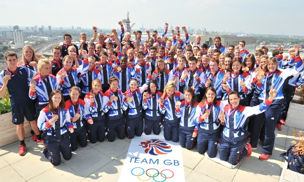 Great Britain's gold medalists stand on the roof of Team GB House to celebrate on the last day of the Olympics.