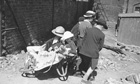 Children play at weddings in rubble West London 1955
