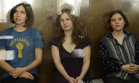 Alyokhina, Samutsevich, and Tolokonnikova, during their trial. (Photo Courtesy of The Guardian)